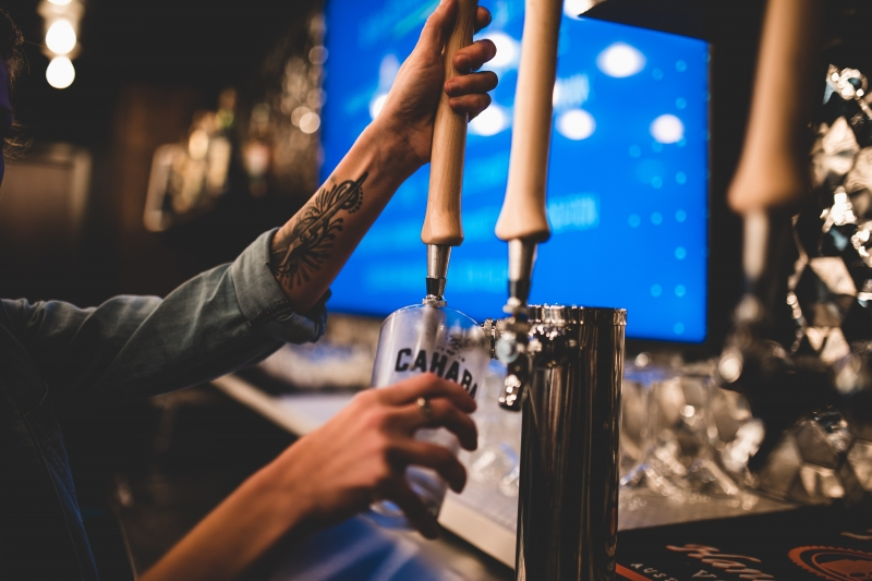 A bartender pulls a draft of Cahaba Beer.