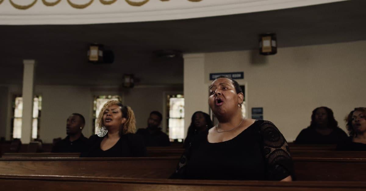 People Singing At Redeemer Community Church